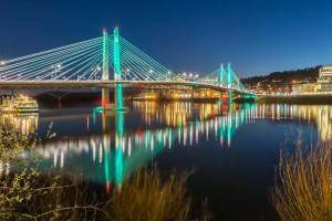 This is the beautifully illuminated Tilikum Crossing, a pedestrian, cyclist and Trimet bridge.
