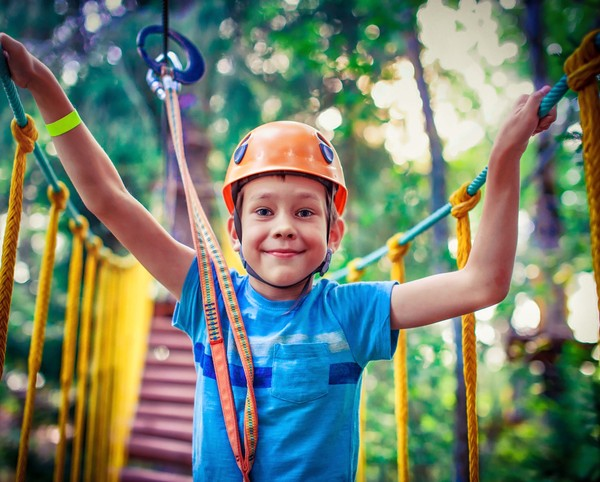 happy boy on the zipline