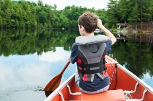 boy in a canoe