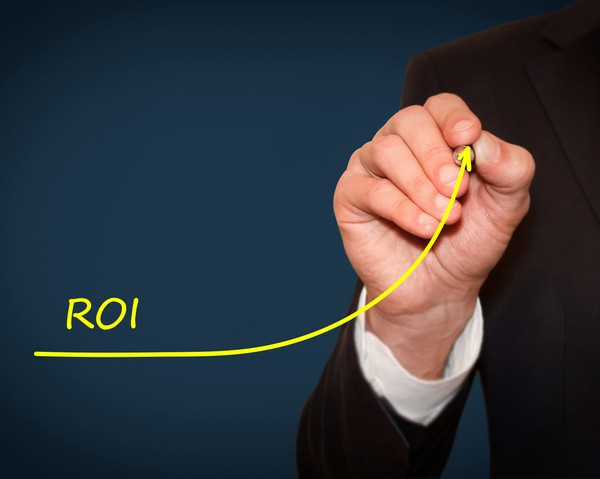 Businessman draw growing line symbolize growing ROI Return on Investment