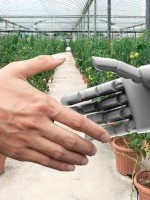 Smart agriculture , Artificial intelligence (AI) advisor or robo-adviser technology. Shaking hands of orchard farmer and automation robot with automation iot smart vegetables farm background.